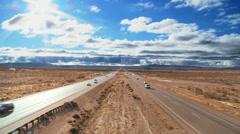 Traffic on a Desert Highway Stock Footage