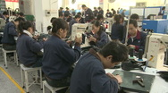 Chinese workers in China Donguan Shoe Factory - workers with sewing machine Stock Footage