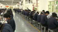 Chinese workers in China Donguan Shoe Factory - production line panoramic shot Stock Footage
