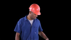 Blue collar worker - break time - pulls banana from pocket Stock Footage