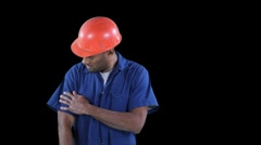 Blue collar worker start cleaning his jump suit with roller - shoulders Stock Footage