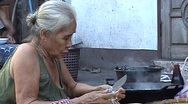 Woman cooking on the street Stock Footage