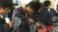 Chinese workers in China Donguan Shoe Factory - production line close up Stock Footage