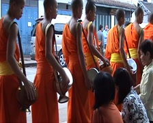 Monks on alms-round Stock Footage