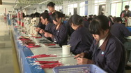 Chinese workers in China Donguan Shoe Factory - foreman watching prod. line Stock Footage