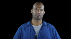 Black man in workers jumpsuit - serious attentive look Stock Footage