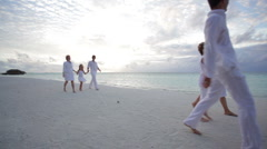 two families walking on beach at sunset - stock footage