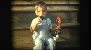 Adorable blonde little boy eating ice cream bar Stock Footage