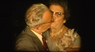 Elderly couple kisses Stock Footage
