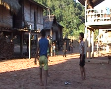 Khmu children playing with wicker ball Stock Footage