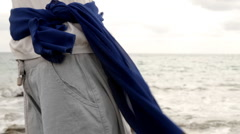 Womans body with sarong standing on seashore  Stock Footage