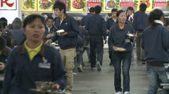 Chinese workers in China Donguan Shoe Factory - lunch time medium shot - stock footage