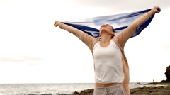 Attractive woman with blue sarong at the beach, shot at 60fps, slow motion  Stock Footage