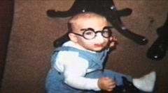Baby Wearing Funny Glasses (1964 Vintage 8mm film) Stock Footage