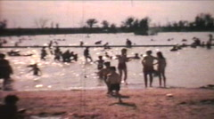 Kids Playing At The Beach (1966 - Vintage 8mm film) Stock Footage