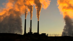 Stock Video Footage of Power Station Chimneys Smoke at Sunrise
