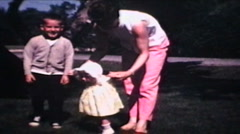 Family In Front Yard (1968 Vintage 8mm film) Stock Footage