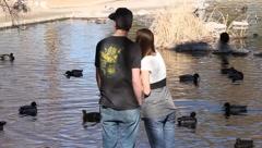 Duck pond teen lovers Stock Footage