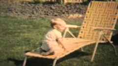 Boy Plays With Garden Hose (1963 Vintage 8mm film) Stock Footage