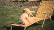 Stock Video Footage of Boy Plays With Garden Hose (1963 Vintage 8mm film)