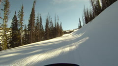 Snowmobile groomed trail into sun HD GP 4 Stock Footage