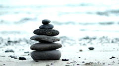 Zen stones on a beach, dolly shot Stock Footage