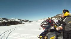 Snowmobile riders top of mountain HD GP 5 Stock Footage