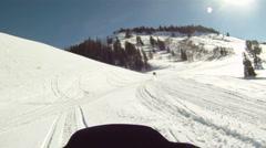 Snowmobile trail into sun HD GP 1 Stock Footage
