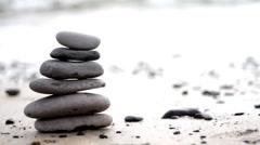 Zen stones on a beach - stock footage