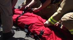 Firefighters Strap Patients Body In Safety Rig Stock Footage