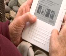 Arthritic Elderly mans hands holding kindle CU OTS Stock Footage