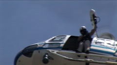 Medic Raises Patient to Helicopter - Medium CU - stock footage