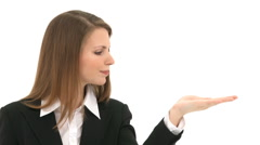 Woman blows something from her hand (copyspace) - stock footage