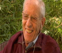 Happy Elderly man smiles listening to music with earbuds Stock Footage