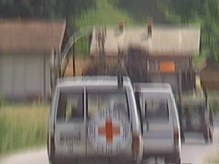 Following Red Cross NGO vehicles on highway through war torn Bosnia, immediate p Stock Footage