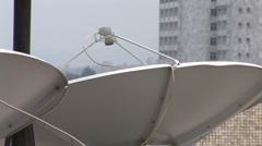 Satellite dishes on an African rooftop - stock footage