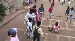 Ethiopian children playing a jump-rope game Stock Footage