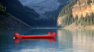 Red Canoes on Lake Louise in Banff National Park, Canada Stock Footage