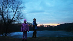 Boy and girl stand in wood, father with chinese lantern, part1 Stock Footage
