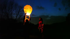man does attempt to start lantern, then gives its wife, son and daughter look - stock footage