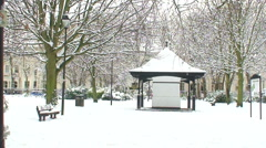 Park bandstand in mid winter snow Stock Footage