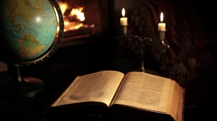 Reading in front of the fireplace - stock footage