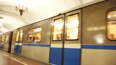 Train moving away from subway station Stock Footage