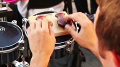 Man of brass band plays castanets Stock Footage