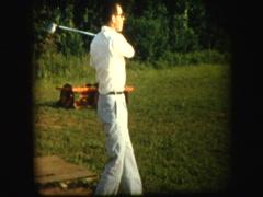Man at driving range hitting golf balls Stock Footage