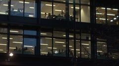 Office workers working late- Time lapse Stock Footage