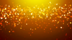 Loopable orange glitter and sparkles Stock Footage