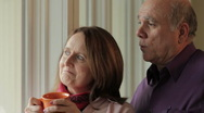 Senior couple looking out window Stock Footage