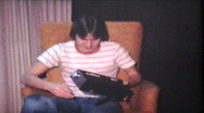 Teenager Gets Clock Radio For Birthday (1978 Vintage 8mm film) Stock Footage