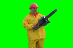 Worker spins with chainsaw on the Green Screen LOOP NTSC - stock footage